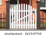 White Wooden Gate And Low Fenc...