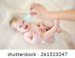 baby watching mother holding a... | Shutterstock . vector #261523247