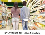 couple shopping in a supermarket | Shutterstock . vector #261536327