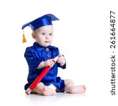 Small photo of Baby with big pencil in academician clothes