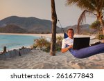 man uses laptop remotely at the ... | Shutterstock . vector #261677843