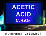Small photo of Tablet with chemical formula of acetic acid.