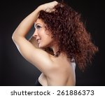 beautiful young woman with red... | Shutterstock . vector #261886373