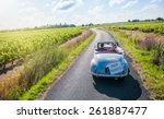 a newlywed couple is driving a... | Shutterstock . vector #261887477