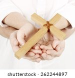 cross in family hands | Shutterstock . vector #262244897