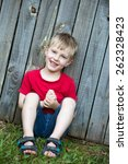 a young 4 year old boy is... | Shutterstock . vector #262328423