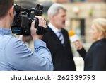 cameraman recording female... | Shutterstock . vector #262339793