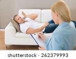 female psychologist making