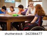 teacher helping a disabled... | Shutterstock . vector #262386677