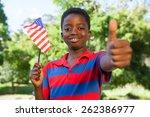 little boy waving american flag ... | Shutterstock . vector #262386977