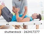 doctor examining his patient... | Shutterstock . vector #262417277