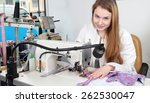 a seamstress woman sewing in a  ...   Shutterstock . vector #262530047
