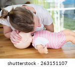 woman performing cpr on baby... | Shutterstock . vector #263151107