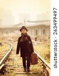 cute boy on a railway station | Shutterstock . vector #263499497