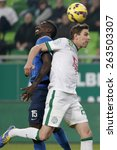 Small photo of BUDAPEST, HUNGARY - MARCH 22, 2015: Air battle between Zoltan Gera of Ferencvaros (r) and Thiam Khaly Iyane of MTK during Ferencvaros vs. MTK OTP Bank League football match in Groupama Arena.