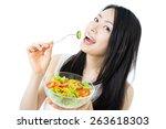 beautiful young woman eating... | Shutterstock . vector #263618303