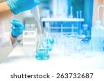 doctor using electronic pipette ... | Shutterstock . vector #263732687