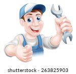 a plumber or mechanic in hat... | Shutterstock . vector #263825903