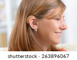 young  smiling woman wearing... | Shutterstock . vector #263896067