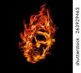 skull in flame on dark...