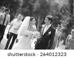 wedding couple walking in the... | Shutterstock . vector #264012323