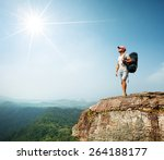 hiker with backpack standing on ... | Shutterstock . vector #264188177