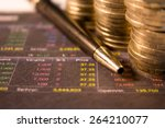 stocks graph with coins | Shutterstock . vector #264210077