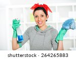 woman holding a cleaning spray... | Shutterstock . vector #264265883
