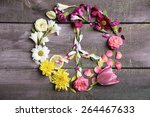 Small photo of Peace symbol of beautiful flowers, on wooden table