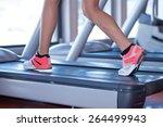 fit female legs on a treadmill...   Shutterstock . vector #264499943
