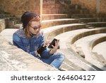 freelancer guy with dreadlocks... | Shutterstock . vector #264604127