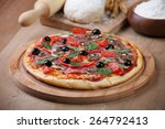 fresh pizza and ingredients on ... | Shutterstock . vector #264792413