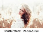 sunny portrait of a beautiful... | Shutterstock . vector #264865853