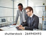 happy young businessman typing... | Shutterstock . vector #264940493