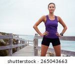 sporty young woman standing on... | Shutterstock . vector #265043663
