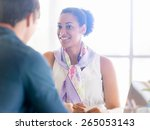 collegues working together in... | Shutterstock . vector #265053143