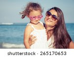 mother and daughter playing on... | Shutterstock . vector #265170653