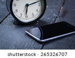 Black Alarm Clock With Cell...
