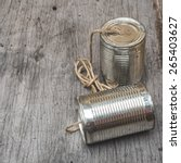 Old Tin Can Phone On Wood...