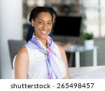 young woman in an office | Shutterstock . vector #265498457