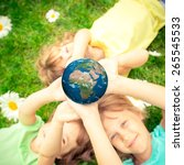 children holding 3d planet in...