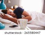sleeping man being woken by... | Shutterstock . vector #265580447
