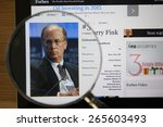 Small photo of CHIANGMAI, THAILAND - April 1, 2015: Photo of Forbes article page about Laurence D. Fink on a ipad monitor screen through a magnifying glass.
