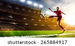 soccer player in action on... | Shutterstock . vector #265884917