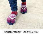 female feet in socks with pink... | Shutterstock . vector #265912757