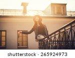 sunny portrait of a happy girl... | Shutterstock . vector #265924973