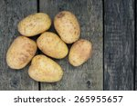 Raw Potatoes On Wooden Boards ...