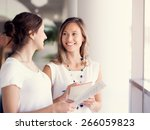two female collegues standing... | Shutterstock . vector #266059823