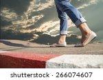 woman walking on the road | Shutterstock . vector #266074607
