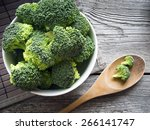 Raw Broccoli On Wooden...